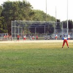 youth baseball field with players